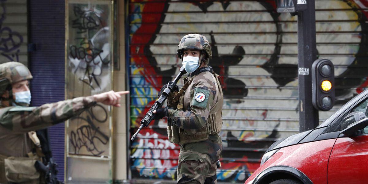Paris stabbing suspect wasn't on police radar, minister says
