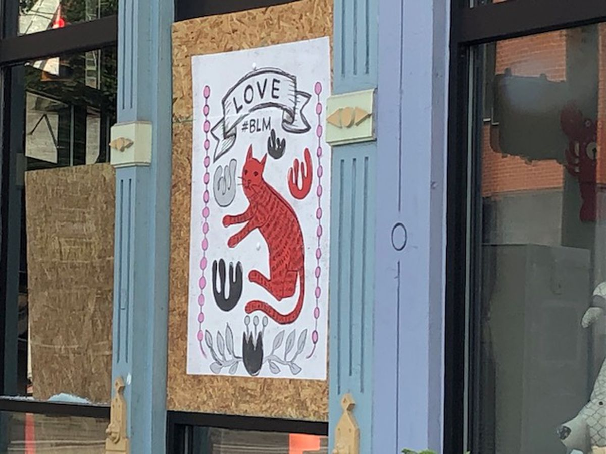 OTR businesses show support for protests with art on window boards
