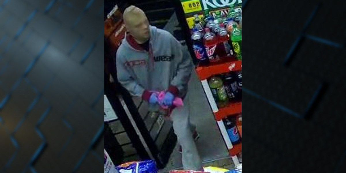 Man with pantyhose over his head wanted in robbery