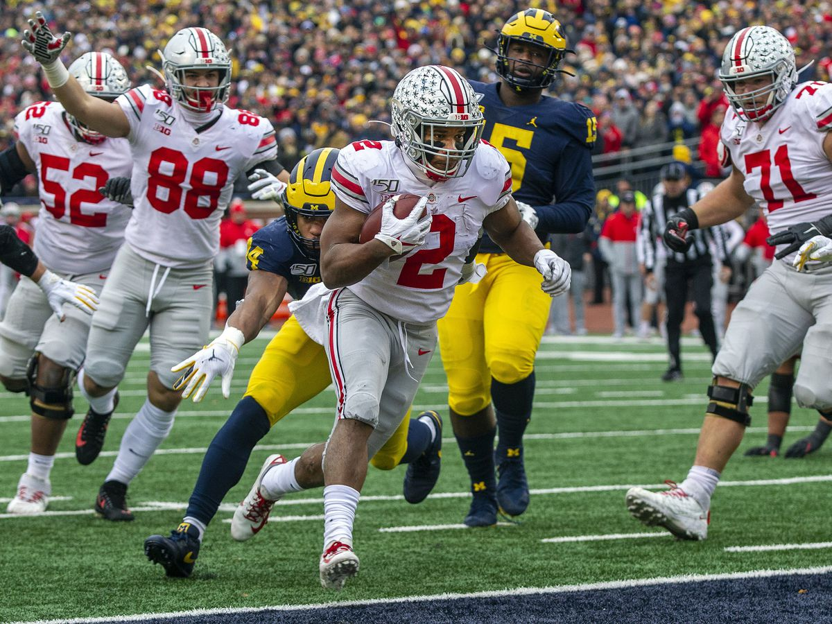 Buckeyes defeat Michigan to complete perfect regular season