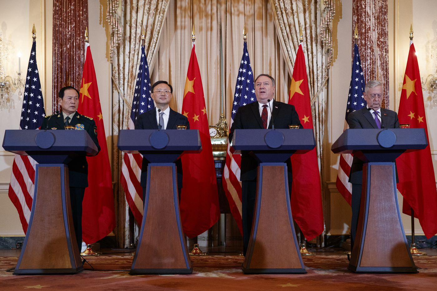 From left, Chinese State Councilor and Defense Minister General Wei Fenghe, Chinese Politburo Member Yang Jiechi, Secretary of State Mike Pompeo, and Secretary of Defense Jim Mattis, participate in a news conference at the State Department in Washington, Friday, Nov. 9, 2018. (AP Photo/Carolyn Kaster)