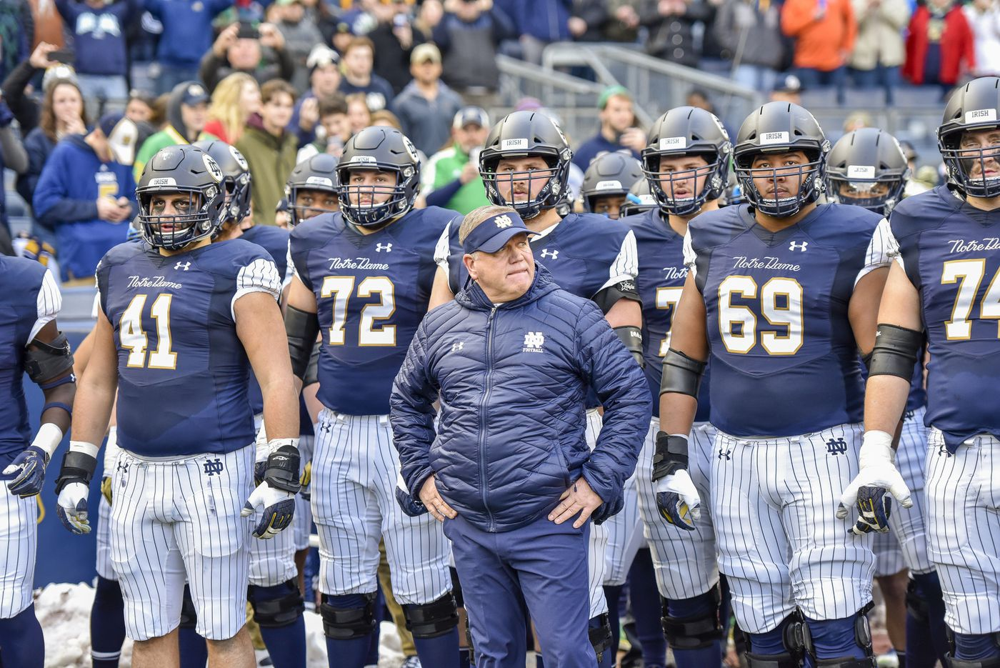 ea9e9a2bd53 Notre Dame head coach Brian Kelly stands with his team before an NCAA  college football game