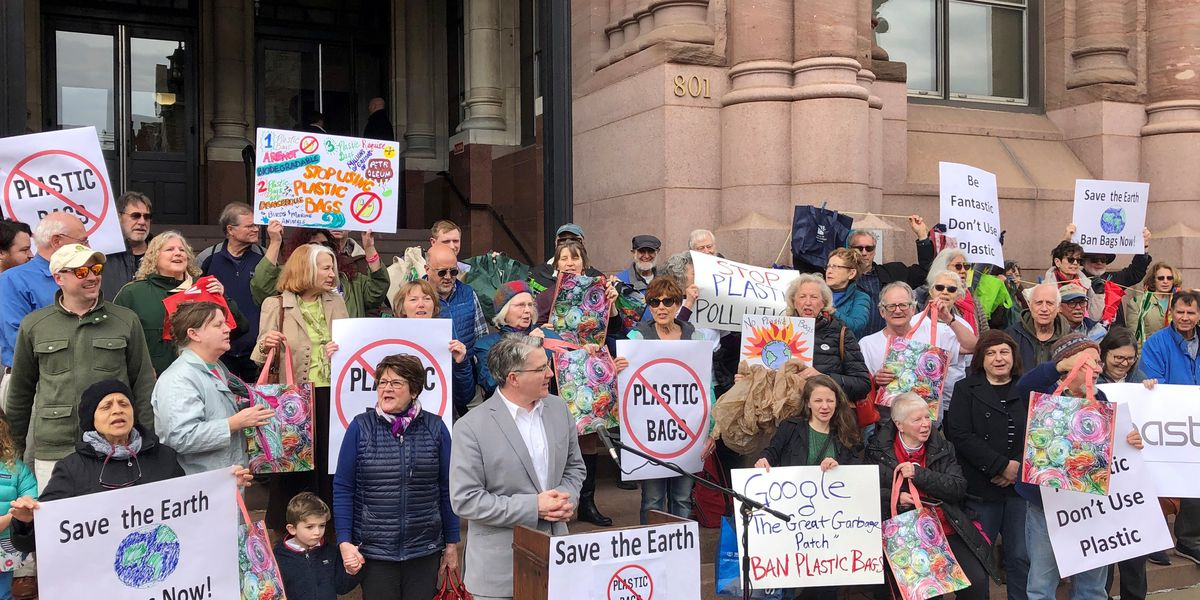Activists rally outside city hall for ban on plastic bags: 'They are poisoning our earth'