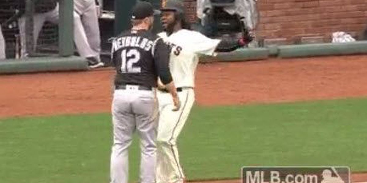 WATCH: Former Red Johnny Cueto chest bumps 1st baseman running down the line
