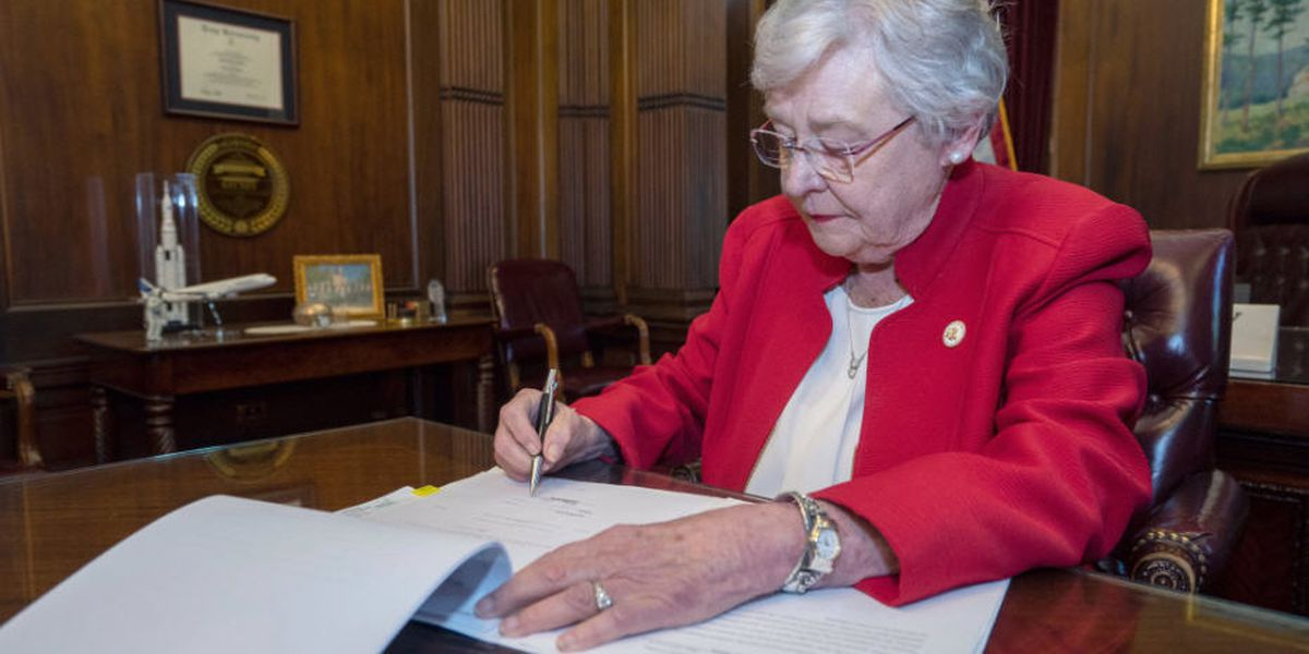 Alabama governor signs near-total abortion ban into law
