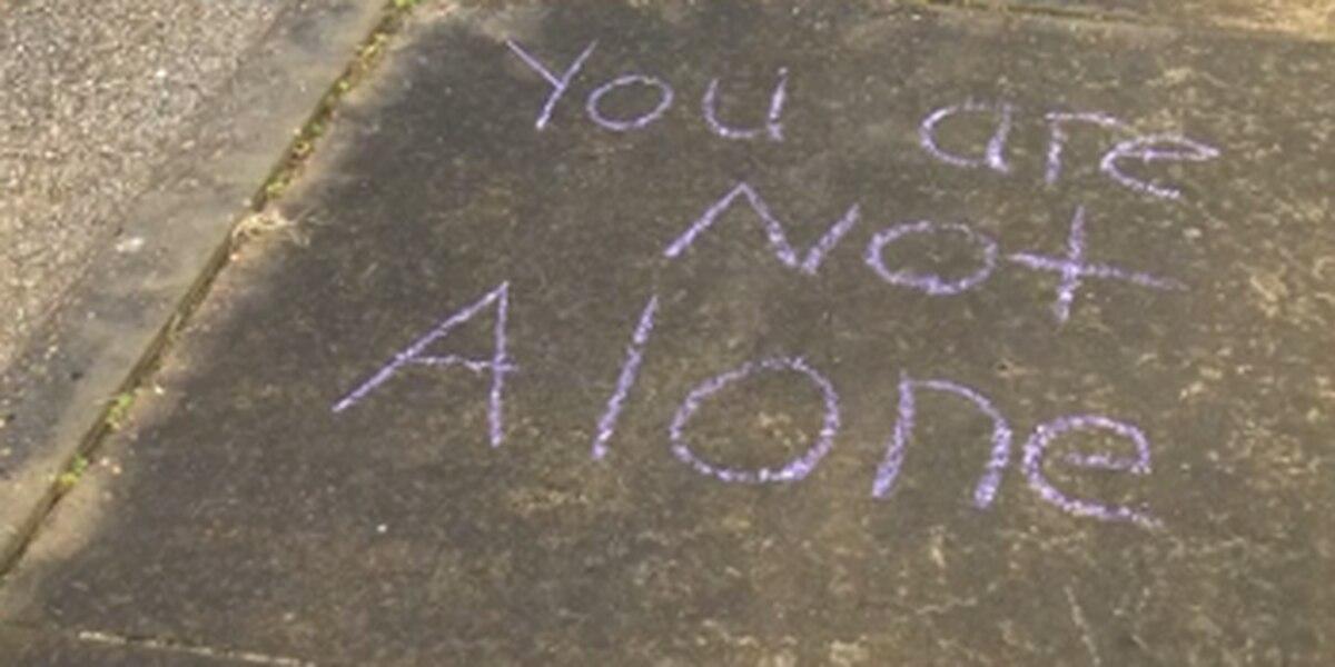 Evansville family spreads cheer through chalk art