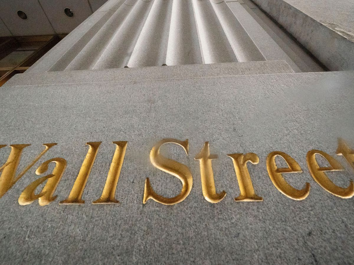 Wall Street hits records amid profit reports, inauguration