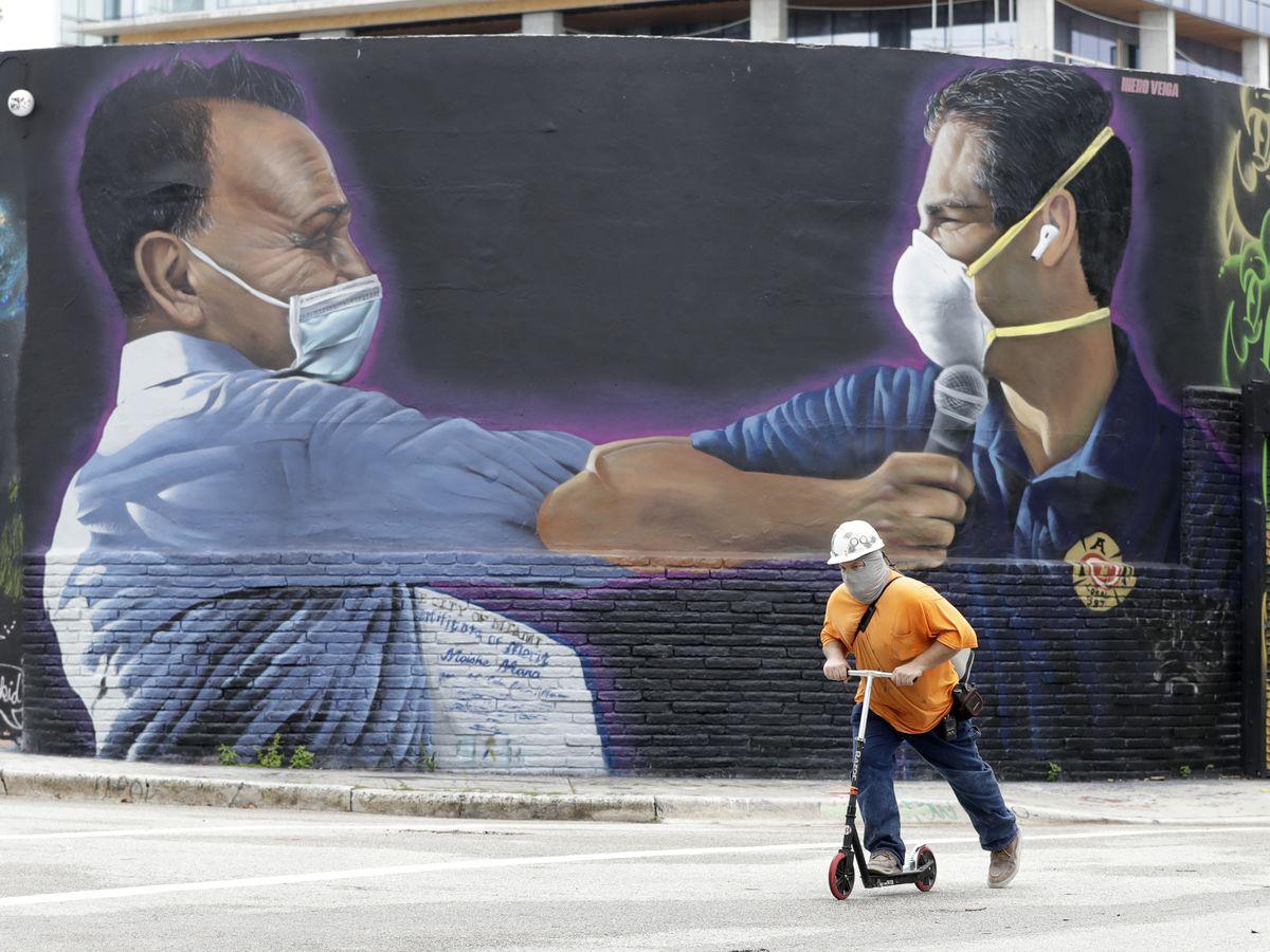 Florida tops virus death mark, UK, France mandate masks