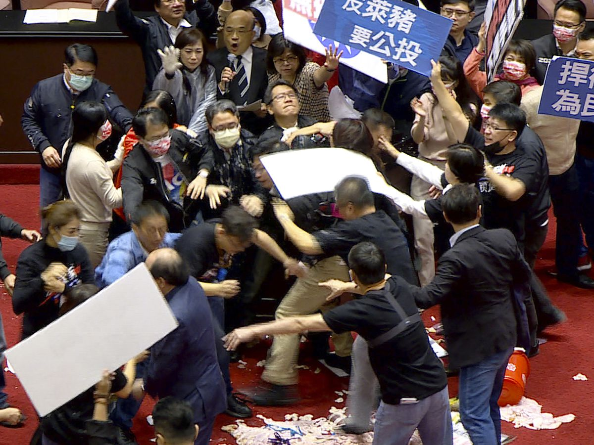 Lawmakers throw pig guts, punches on Taiwan parliament floor