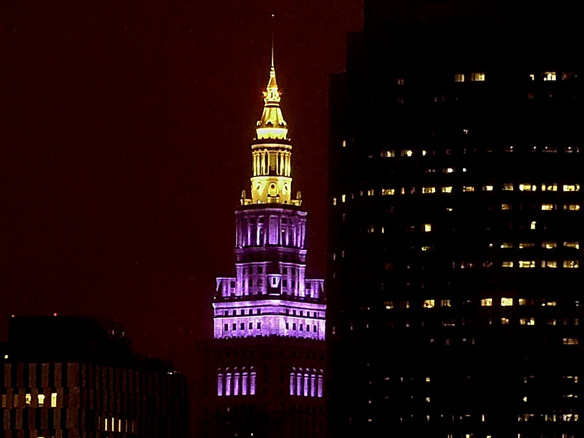 Terminal Tower lit up in purple and gold to honor Kobe Bryant