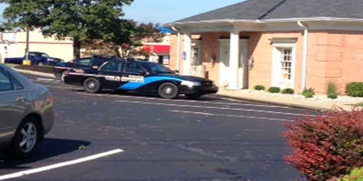 Police: Bank robber wore black garbage bag over his face