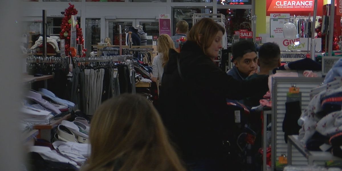 Last minute Christmas shoppers packing stores