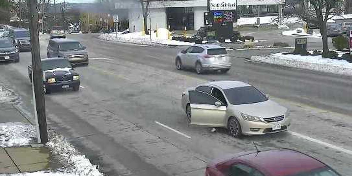 Police ask for tips after woman seen attempting to escape moving car with tinted windows