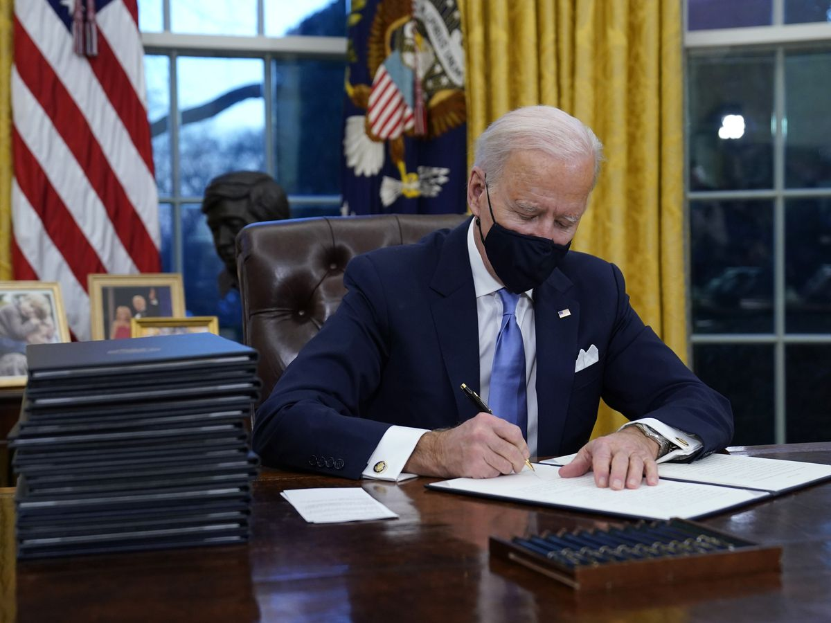 Biden to reinstate COVID travel rules, add South Africa