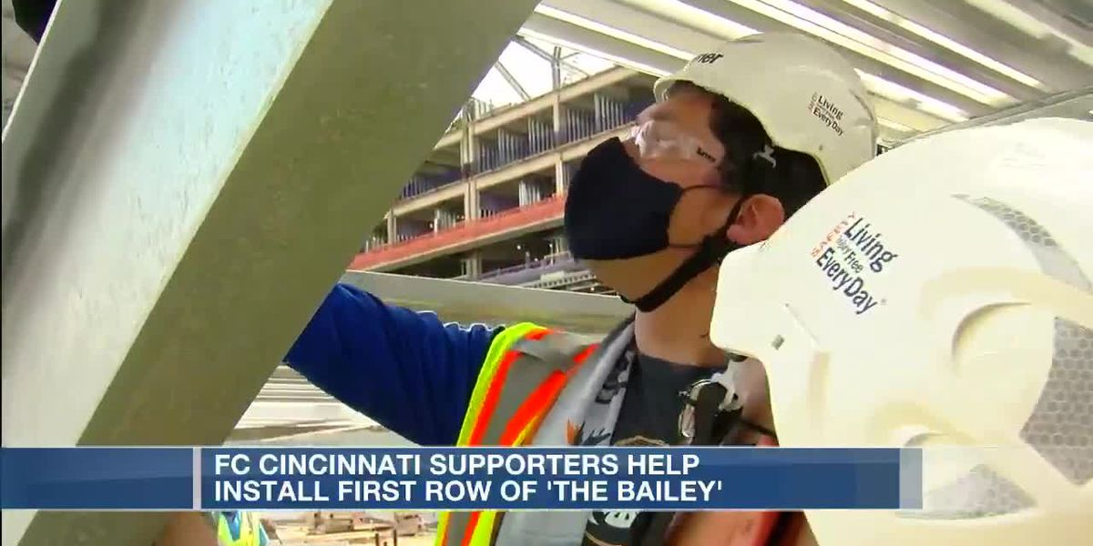 FC Cincinnati supporters help install first row of the Bailey