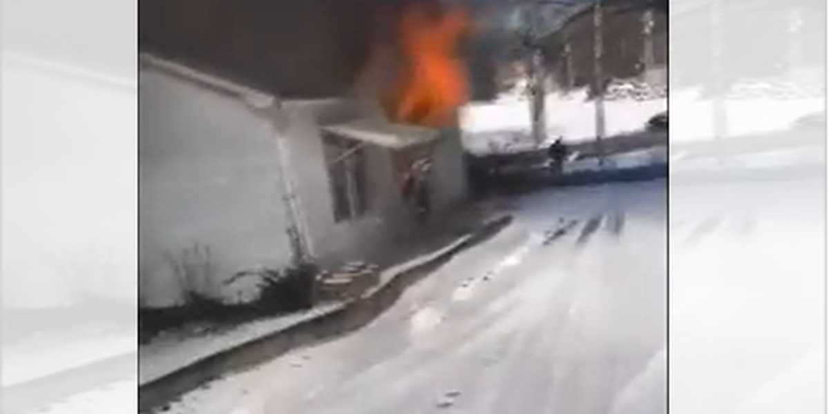 VIDEO: Man rescues neighbor from burning home