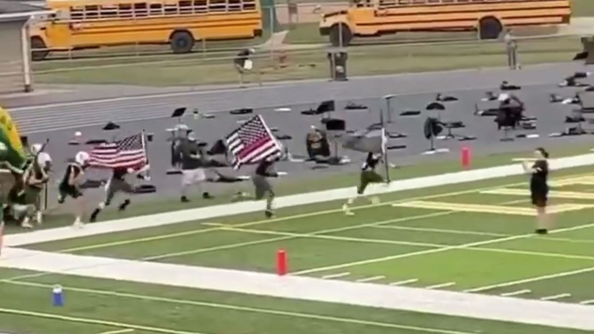 Football players say carrying thin blue line, thin red line flags was to honor first responders, not make statement