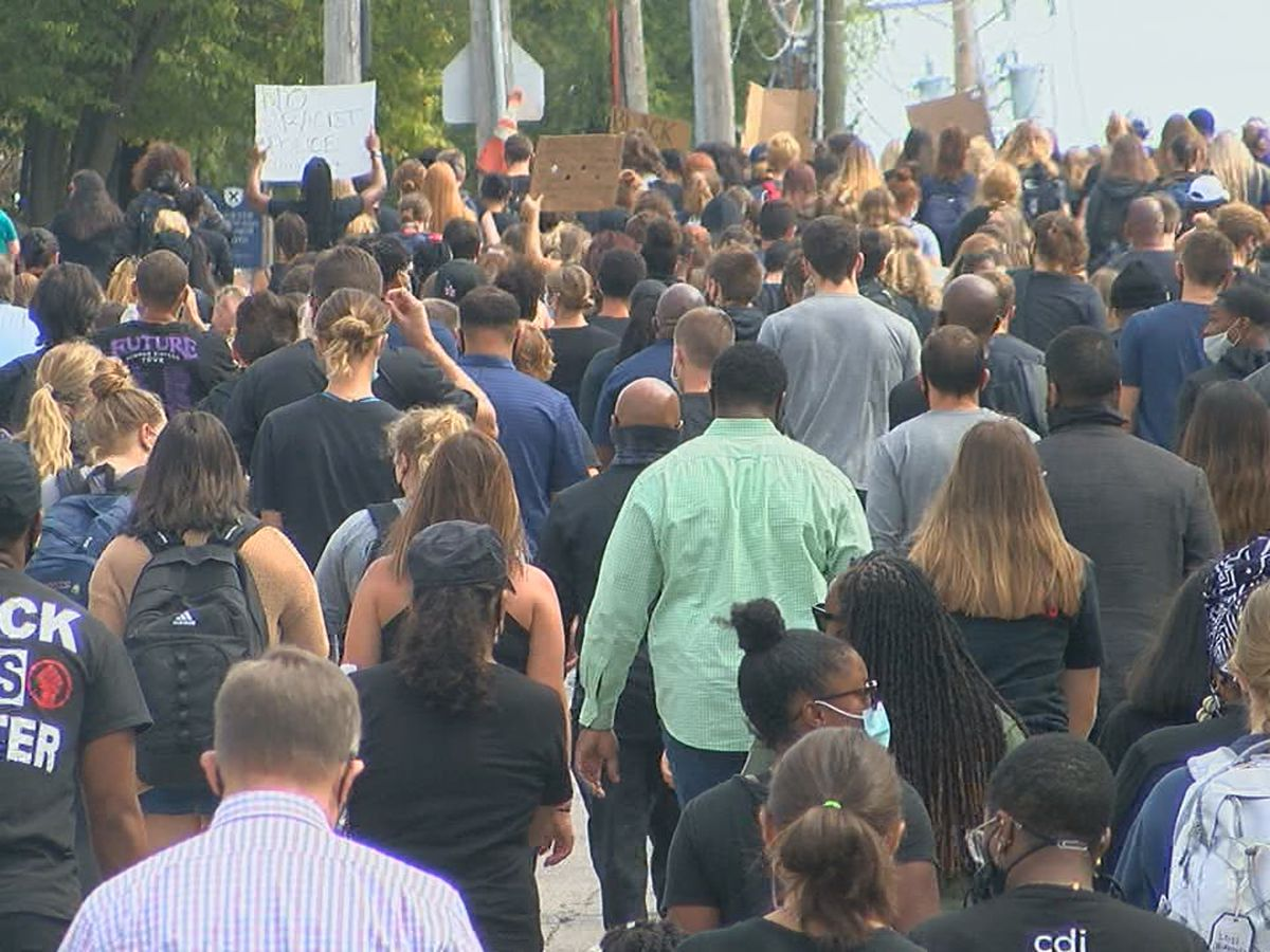 Hundreds march for change at Xavier University