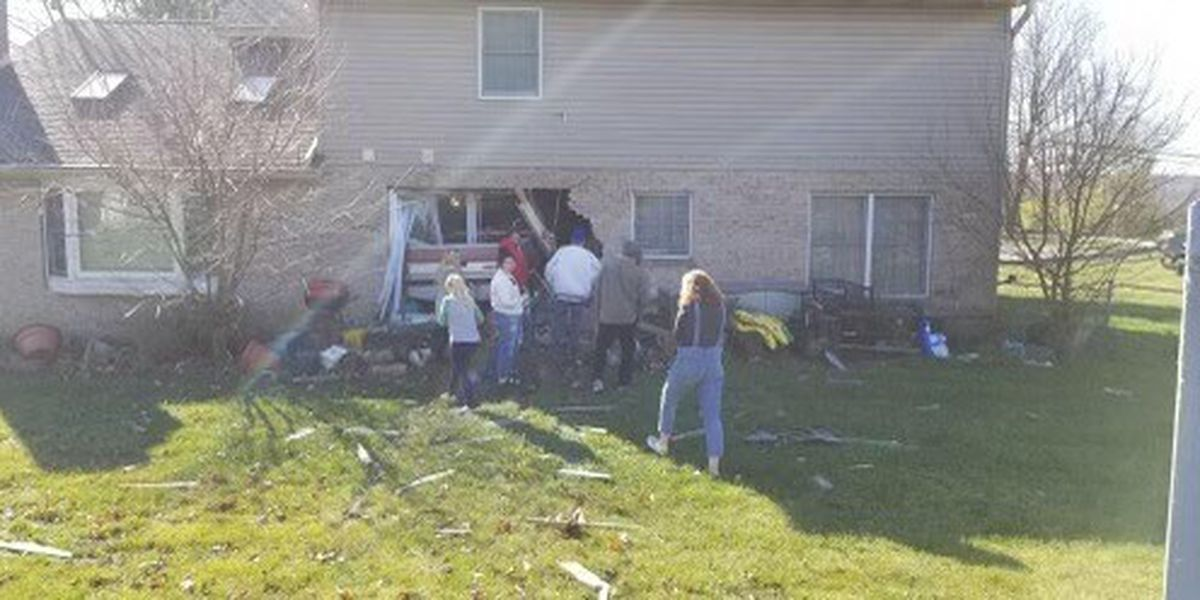 Person killed after pickup truck crashes into house in Monroe