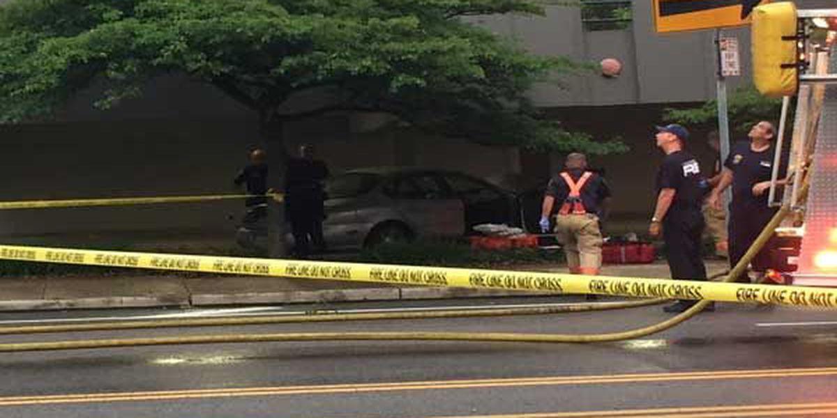 Driver, 60, dies after crashing into tree, parking garage