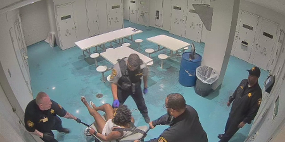 Video shows Cuyahoga County Jail officers hitting, using pepper foam on restrained female inmate