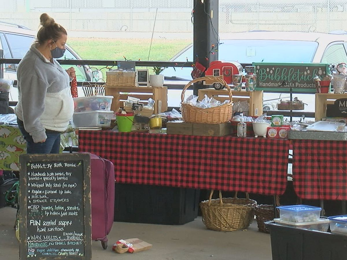 Small business owners set up for Christmas Shopping Bazaar in Lawrenceburg