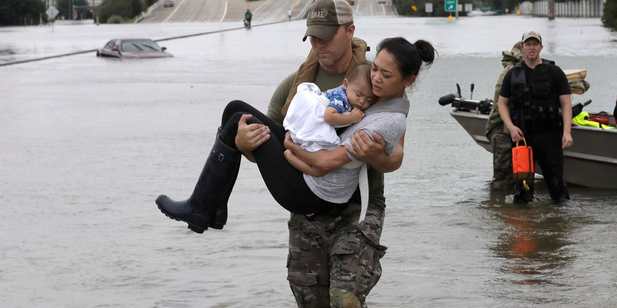SWAT officer in viral photo rescuing hurricane victims: 'All of the first responders are working tirelessly'