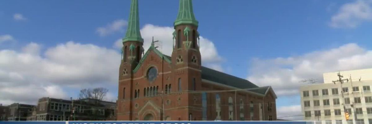Repairs being completed on cross at St. George Church
