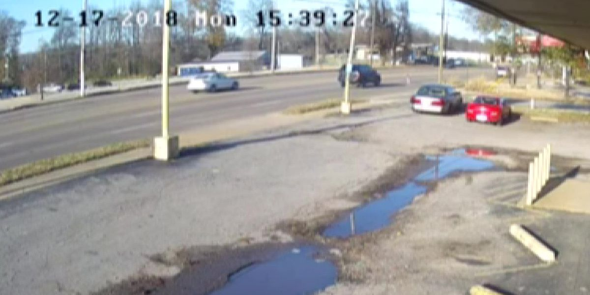 Surveillance video captures moment child falls out of car on busy street