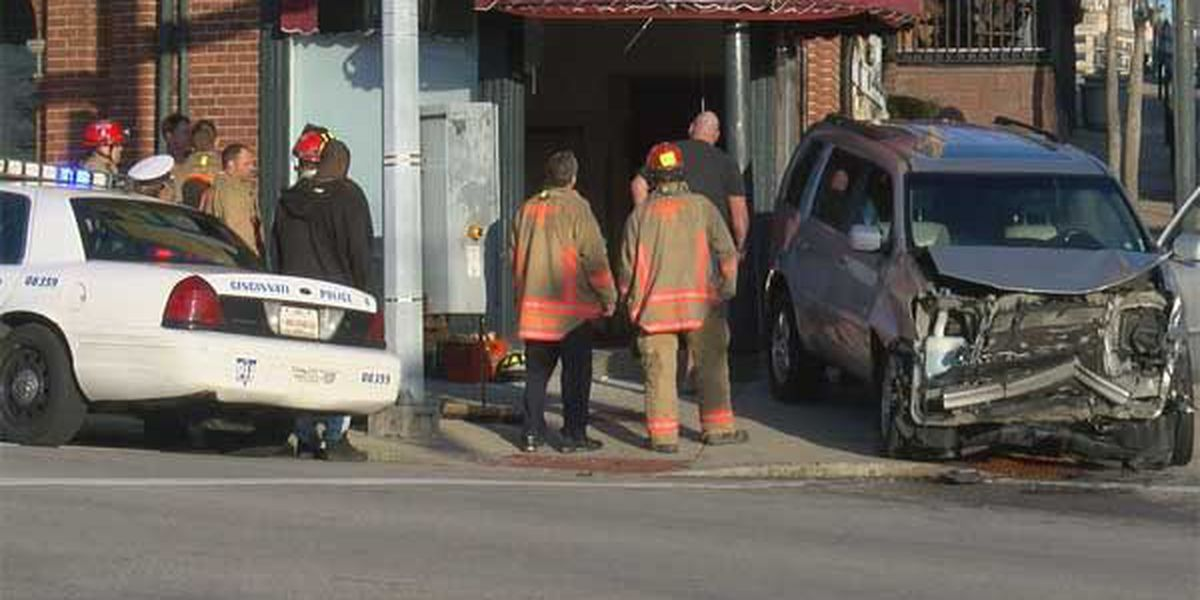 Two vehicle accident in Walnut Hills sends one into nearby apartment building
