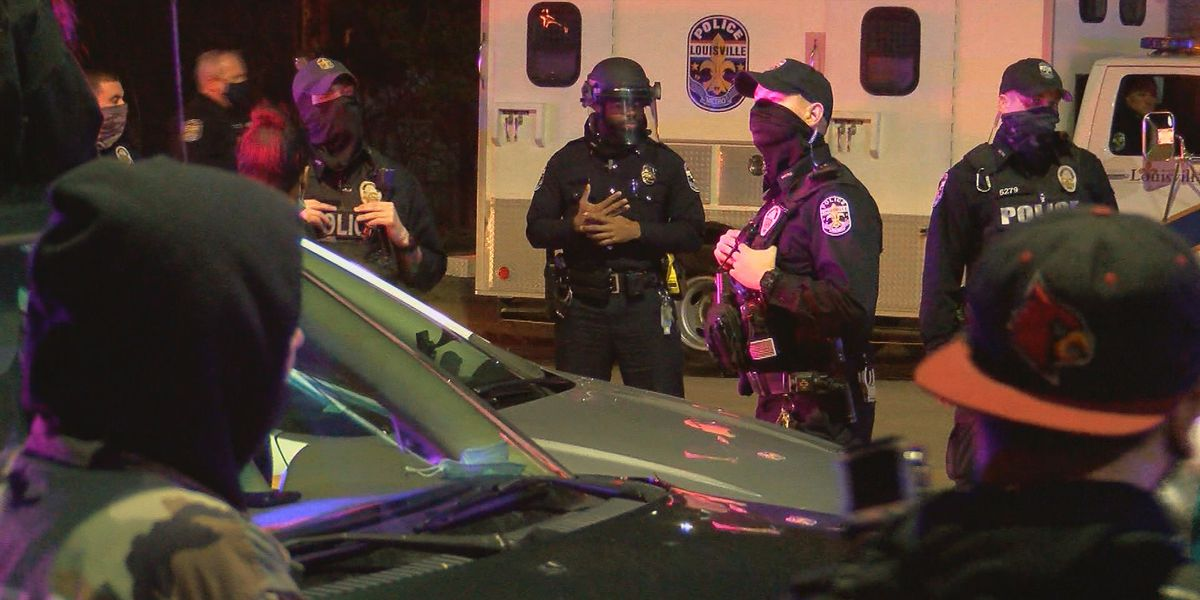 Protesters gather into the night on River Road, LMPD declares unlawful assembly
