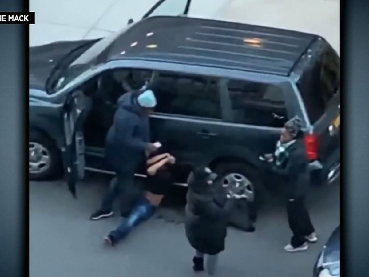 Mom beats, sits on man trying to steal her car