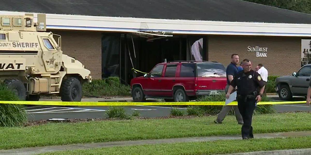 After 5 slain in FL bank, questions remain