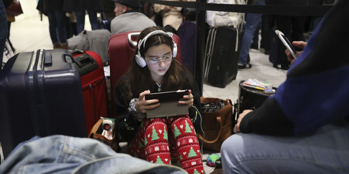 The Latest: Police say 2 arrested Gatwick Airport drone case