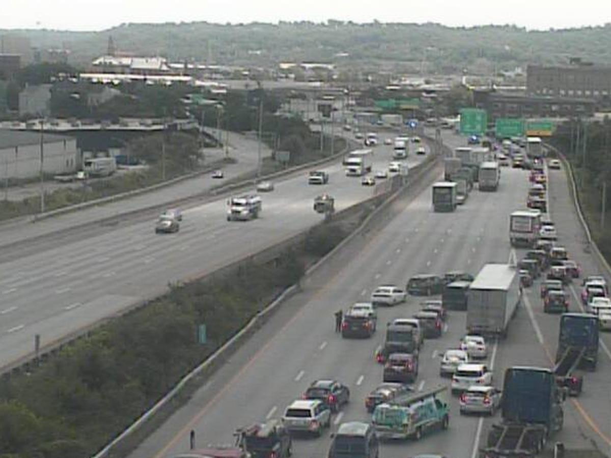 Police: Woman dies in crash involving semi on I-75