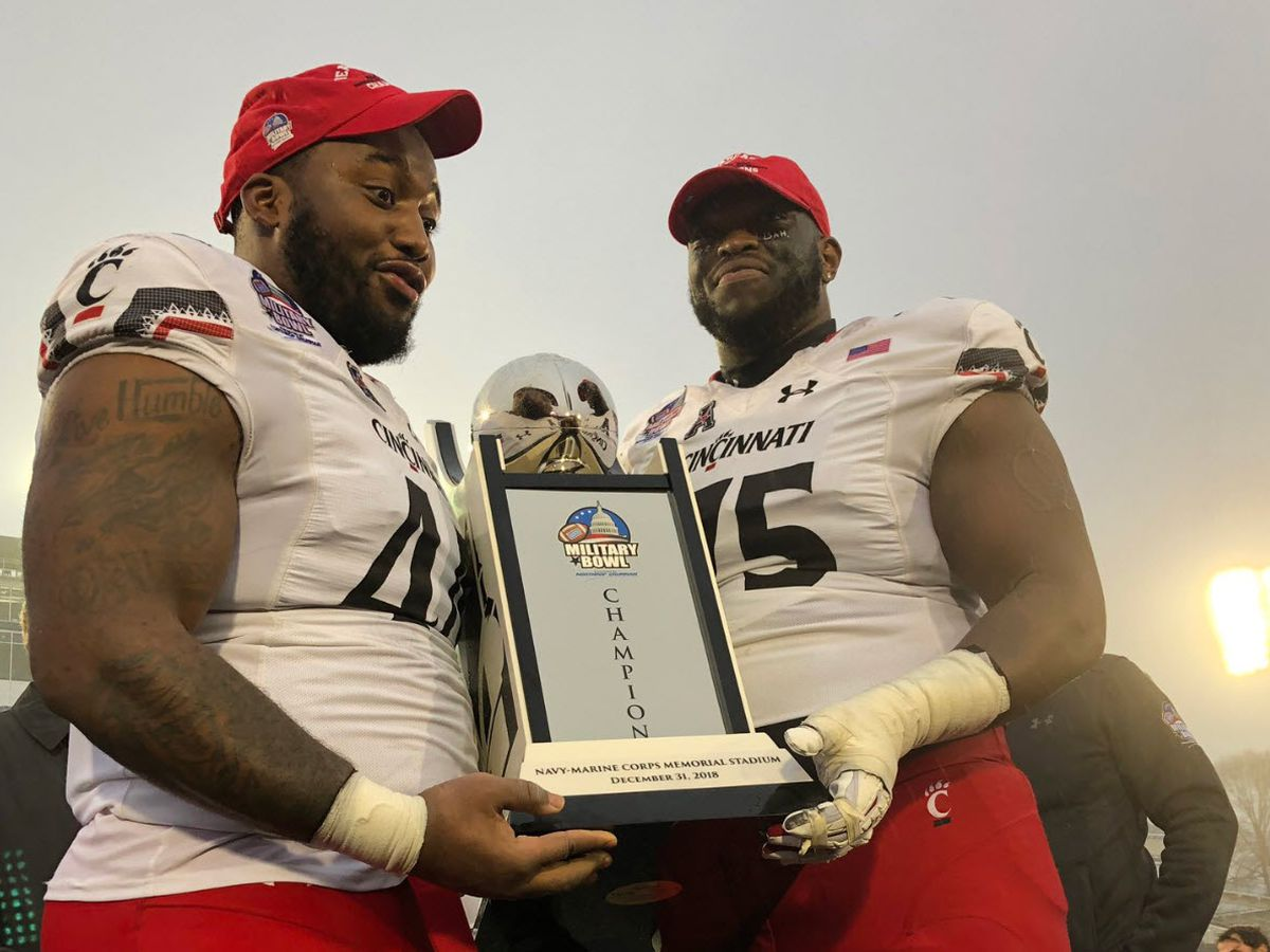 Bearcats climb, Buckeyes drop in new Top 25