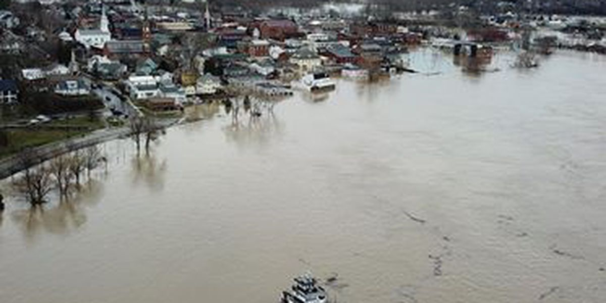 Floodwaters invade downtown Aurora