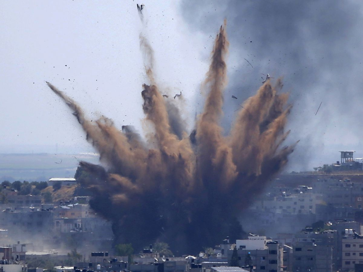 Israel begins firing artillery and tank shells into Gaza