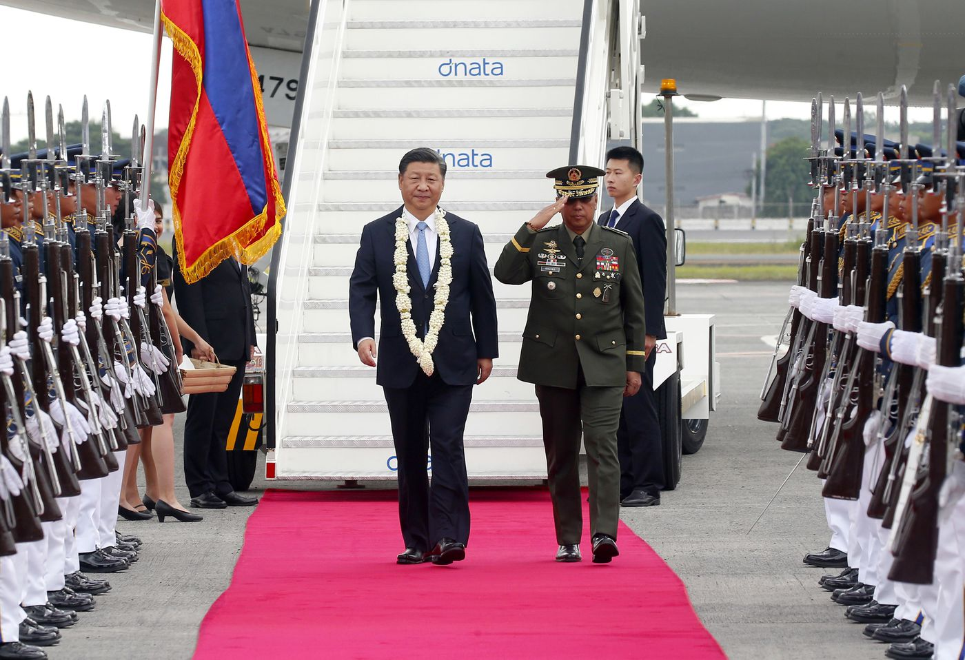 Chinese President Xi Jinping, center left, walks past an honor guard upon arrival at the Ninoy Aquino International Airport in suburban Pasay city, southeast of Manila, Philippines, Tuesday, Nov. 20, 2018. Xi visited the Philippines for the first time to deepen ties with America's ally. Image: AP Photo/Bullit Marquez
