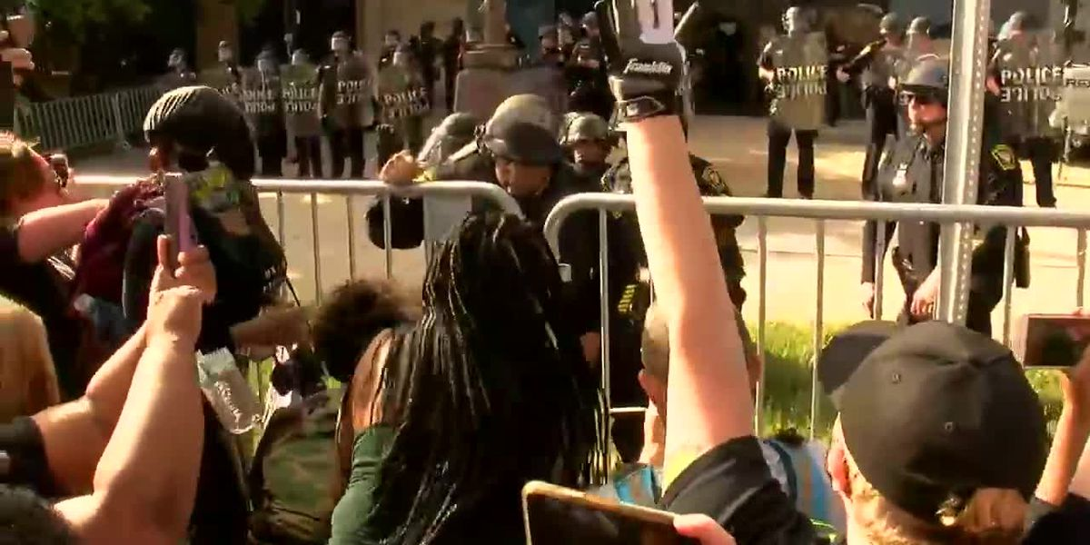 Cincinnati Police Chief Eliot Isaac takes a knee in the wake of calls from protesters