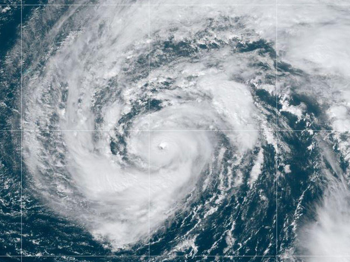 Weakened Hurricane Epsilon skirting just east of Bermuda