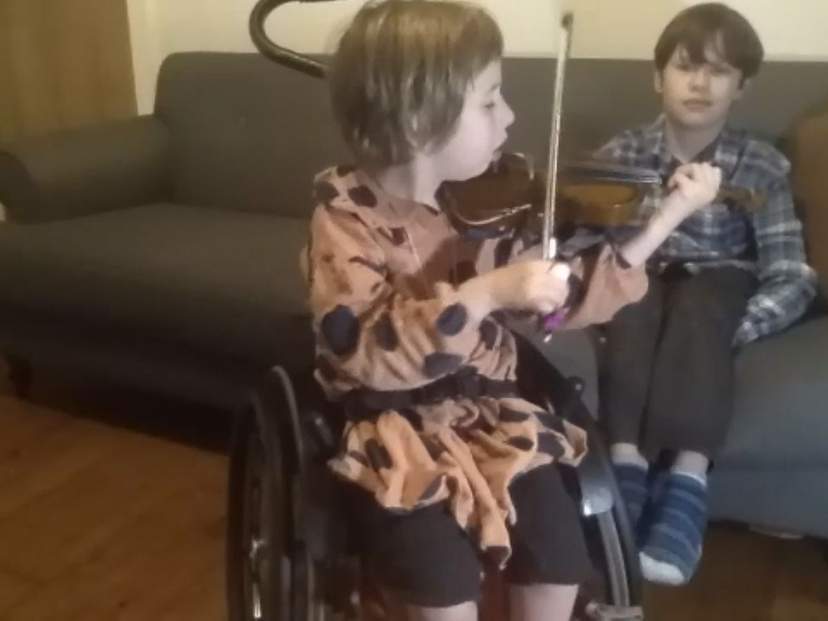 Tri-State students help girl in Scotland play the violin