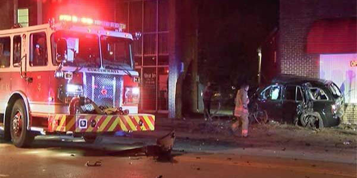 Police: Man runs red light, crashes into car, building