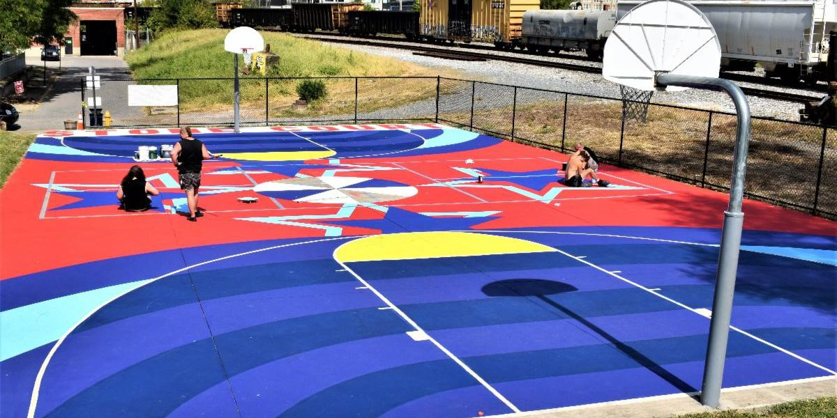 Covington's Stone Court first in a new series of basketball-court murals