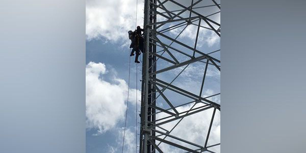 Worker rescued from 300-foot tower