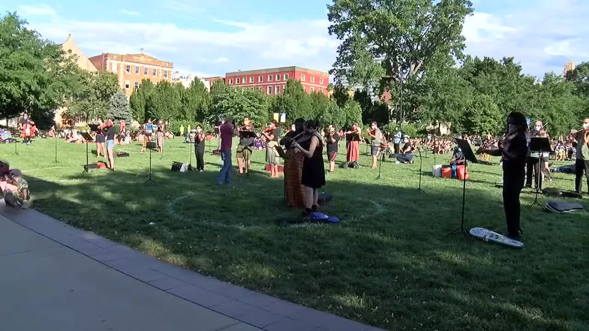 Musicians honor violinist killed during police encounter with musical vigil